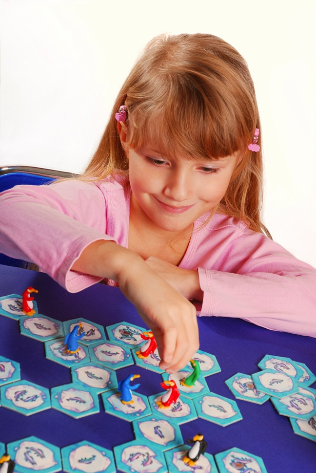 little girl playing the board game